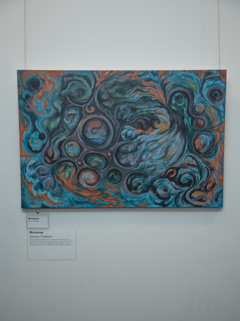 Painting/arkwork of student on the wall display